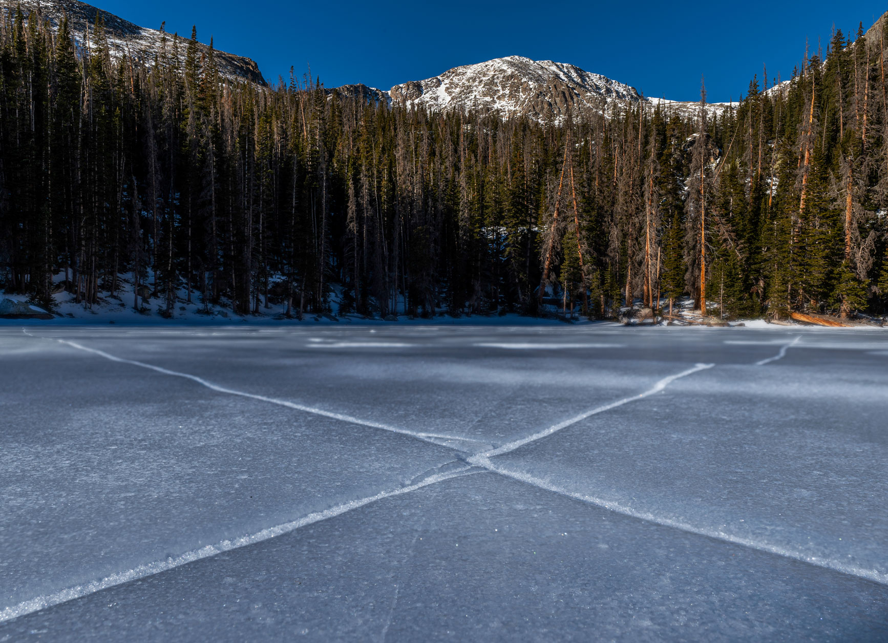 X marks the ice crack in the middle of Ypsilon Lake, looking at Ypsilon Mountain