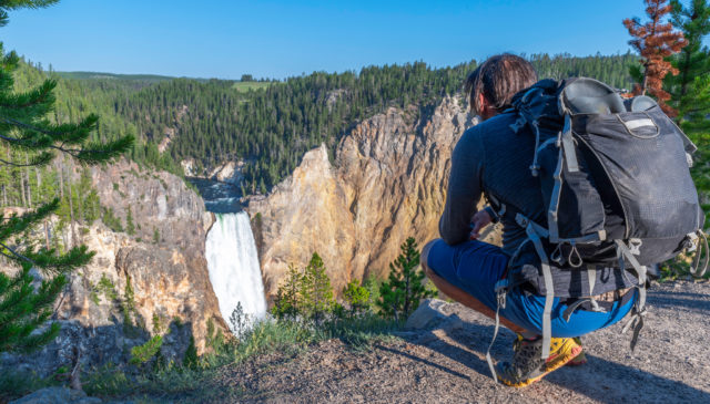 upper yellowstone falls and hiker
